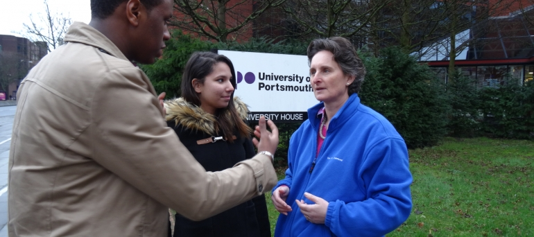 Flick talking to some students outside the University of Portsmouth